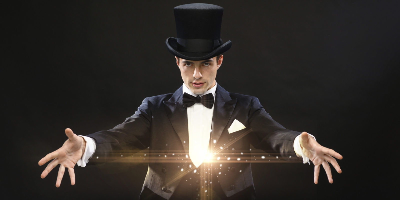 A magician in a top hat conjuring magic